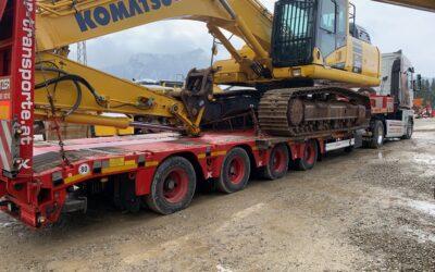 Cargando la excavadora PC360-11 en Austria
